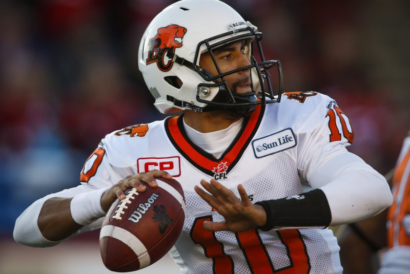 BC Lions quarterback Jonathon Jennings looks of a receiver during first half CFL western semifinal football action against the Calgary Stampeders in Calgary, Sunday, Nov. 15, 2015.THE CANADIAN PRESS/Jeff McIntosh