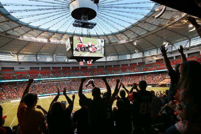 VANCOUVER, BC_SEPT 15_2012: With the roof open fans enjoy the BC Lions 28-23 win over Toronto Saturday afternoon inside BC Place. (Photo by Kim Stallknecht/PNG) (For Story)