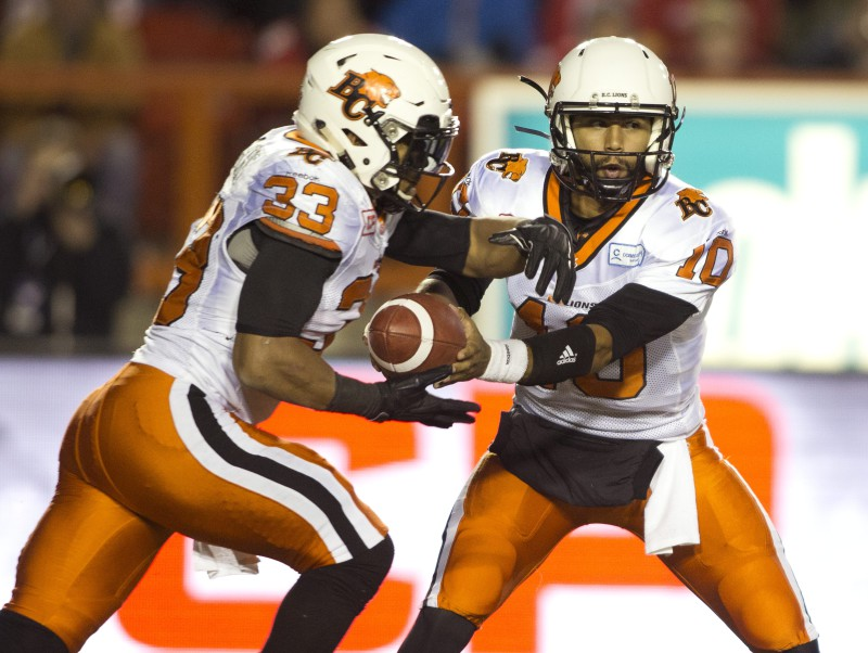 BC Lions' quarterback Jonathon Jennings, right, hands off to Andrew Harris during second half CFL football action against the Calgary Stampeders in Calgary, Alberta on Friday, Sept. 18, 2015. (CFL PHOTO - Larry MacDougal)