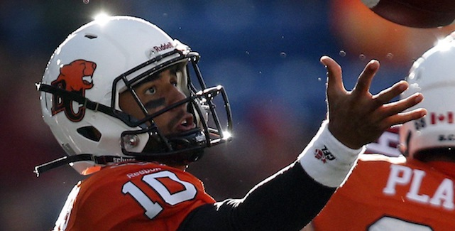B.C. Lions quarterback Jonathon Jennings grabs for a bad snap during first half CFL pre-season football action against the Calgary Stampeders in Calgary, Friday, June 12, 2015.THE CANADIAN PRESS/Jeff McIntosh