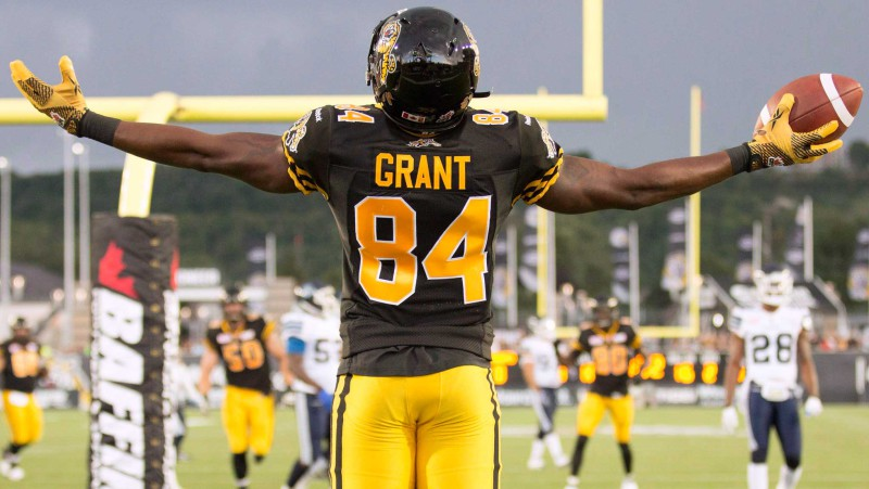 Receiver Bakari Grant celebrates a touchdown as a member of the 2015 Hamilton Tiger-Cats (Photo by Canadian Press/Peter Power)